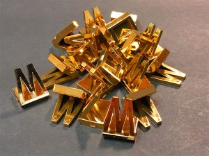 Custom Plastic Pieces with Gold Foil Plating